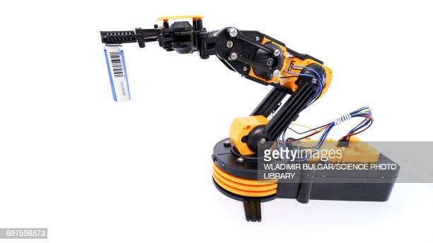 Robotic arm holding barcode
