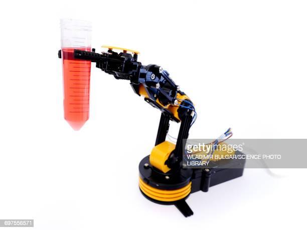 Robotic arm holding beaker