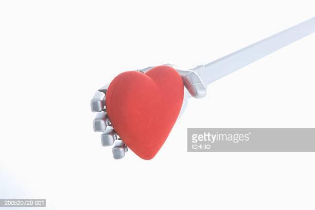 Robotic arm holding heart