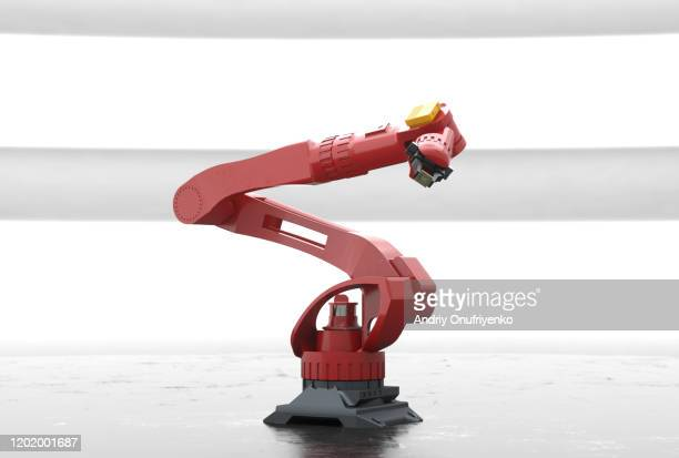 robotic arm holding processor - robot arm stock pictures, royalty-free photos & images