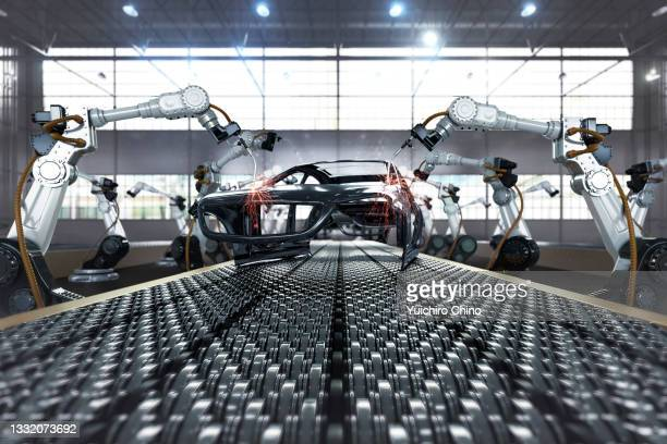 robotic arm in assembly automobile manufacturing plant - transport stock pictures, royalty-free photos & images