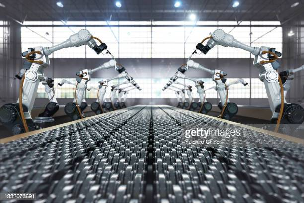 robotic arm in assembly manufacturing factory - robot stock pictures, royalty-free photos & images