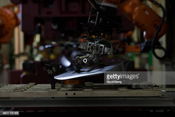 A robotic arm moves a vehicle frame component along the production line at the Hyundai Motor Co factory in Asan South Korea on Monday Jan 20 2014...