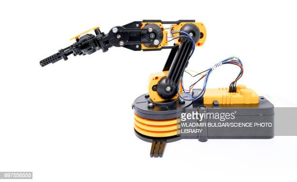 robotic arm - robot arm stock pictures, royalty-free photos & images
