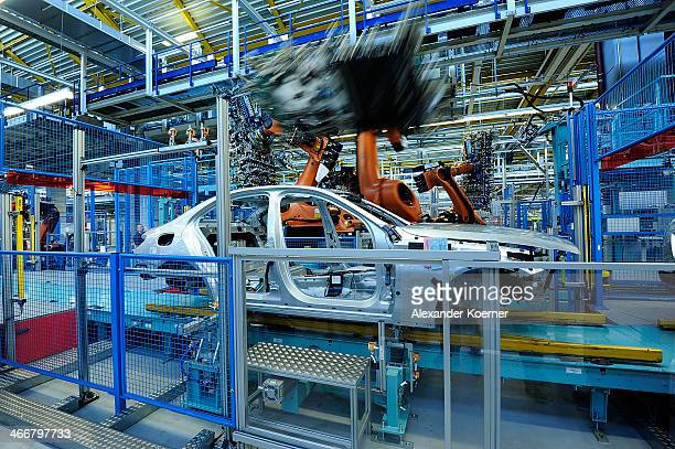 AG robotic arm prepares to install a window of a Daimler AG MercedesBenz CClass automobile on the assembly line at the MercedesBenz plant of Daimler...