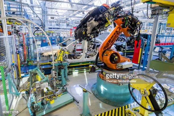 A robotic arm prepares to install the cockpit section of a Daimler AG MercedesBenz SClass sedans at the MercedesBenz plant on January 24 2018 in...