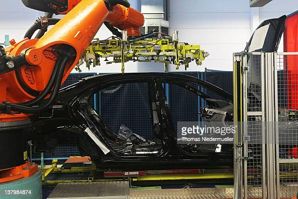 AG robotic arm prepares to install the roof section of a Daimler AG MercedesBenz SClass vehicle on the production line on January 30 2012 in...