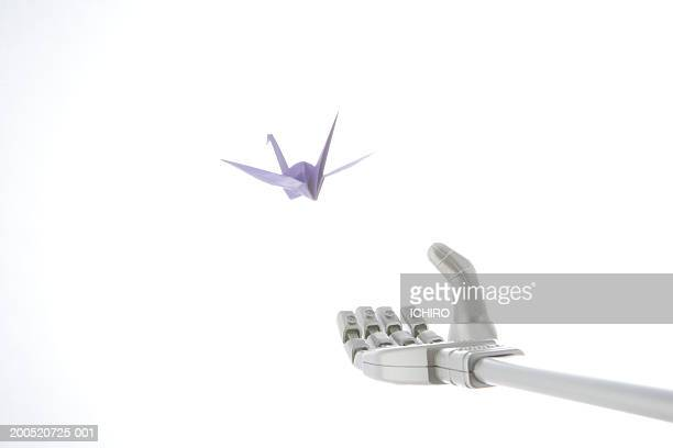 Robotic arm reaching for origami crane