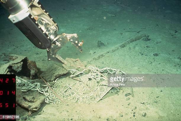 Robotic Arm Retrieving Artifact from Titanic Shipwreck
