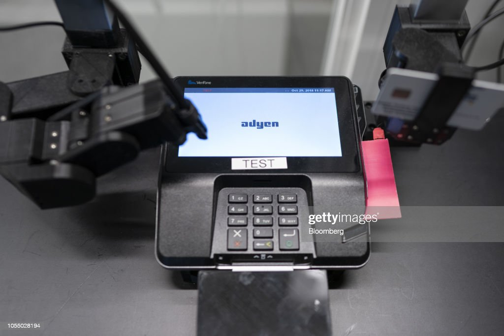 A robotic arm uses the keypad of a contactless payment processing