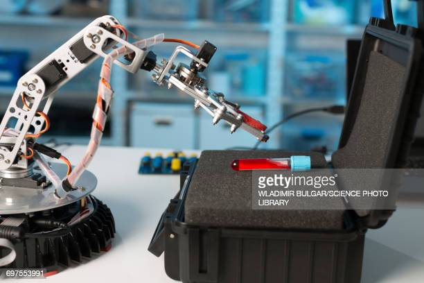Robotic arm with test tube