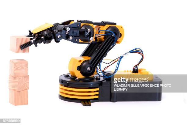 Robotic arm with wooden blocks