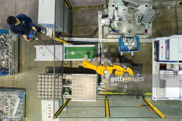 Robotic arm works on the production line of luminaire housing at a smart factory of Zhejiang Hpwinner Scientific Company Limited on October 9, 2020...