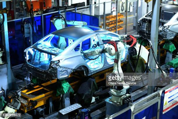 Robotic arms assemble an automobile body shell on the assembly line at an auto plant of Chongqing Chang'an Automobile Co., Ltd on July 21, 2020 in...