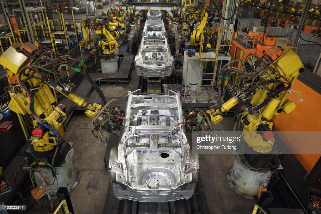Robotic arms assemble and weld the body shell of a Nissan car on the production line at Nissan's Sunderland plant on January 24, 2013 in Sunderland, England. The Japanese manufacturer's factory employs 6,225 people producing the Juke, Note and Qashqai models. In 2012 the Wearside facility built 510,572 cars to become the first ever UK automobile plant to have produced more than half a million cars in a year, which was 34.8 percent of the cars produced in the whole of the UK for 2012.
