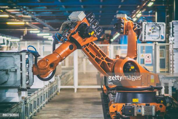 robotic arms handling household appliances - robot arm stock pictures, royalty-free photos & images