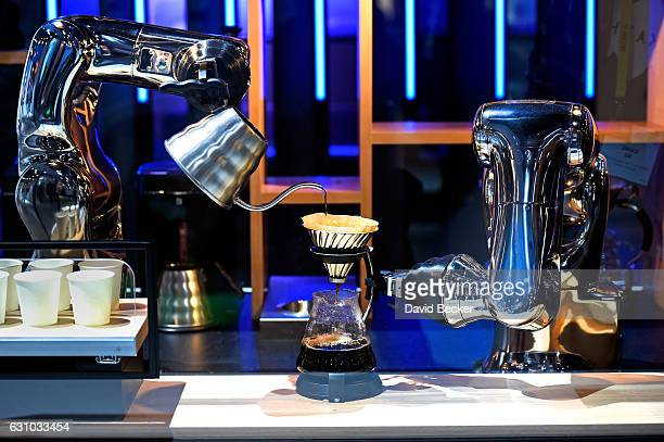 Robotic arms make coffee in a demostration using a pair of VSS2 Series robots at the Denso booth at CES 2017 at the Las Vegas Convention Center on...