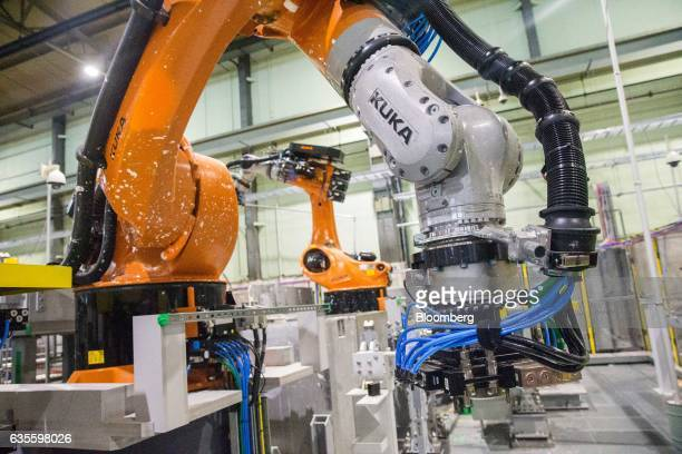 Robotic arms manufactured by Kuka AG perform mock operations on handling contaminated barrels of sludge and debris at the National Nuclear Laboratory...