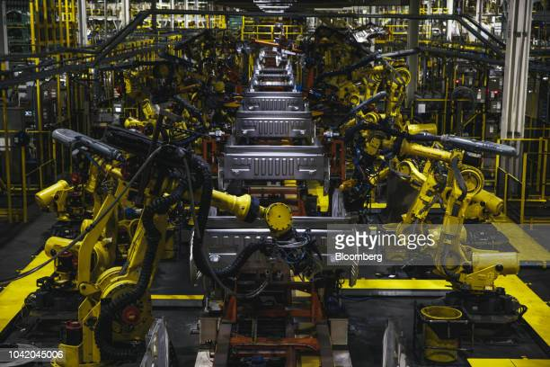 Robotic arms operate on the bed frame of a truck at the Ford Motor Co. Dearborn Truck Plant in Dearborn, Michigan, U.S., on Thursday, Sept. 27, 2018....