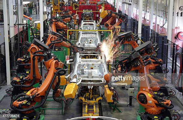 Robotic arms weld body shells of Renault Smart For Four automobiles at the Renault Revoz dd plant a unit of Renault SA in Novo Mesto Slovenia on...