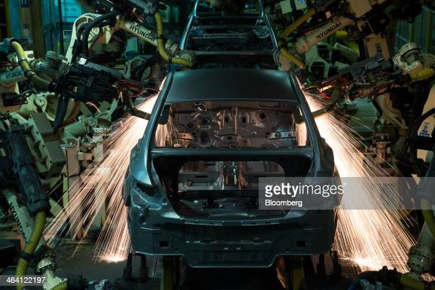 Robotic arms weld vehicle frames on the production line at the Hyundai Motor Co. Factory in Asan, South Korea, on Monday, Jan. 20, 2014. Hyundai,...