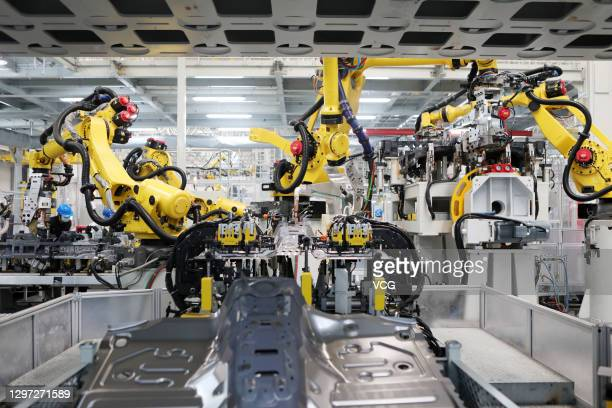 Robotic arms work on the production line of WEY Tank 300 SUV at a factory of Great Wall Motors on January 19, 2021 in Chongqing, China.