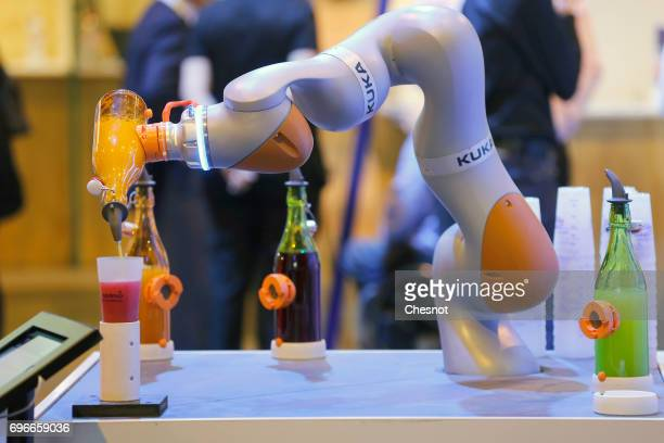A robotic bar system manufactured by Kuka is displayed during the Viva Technology show on June 16 2017 in Paris France Viva Technology the new...