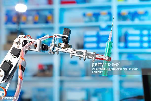 Robotic equipment holding syringe in lab