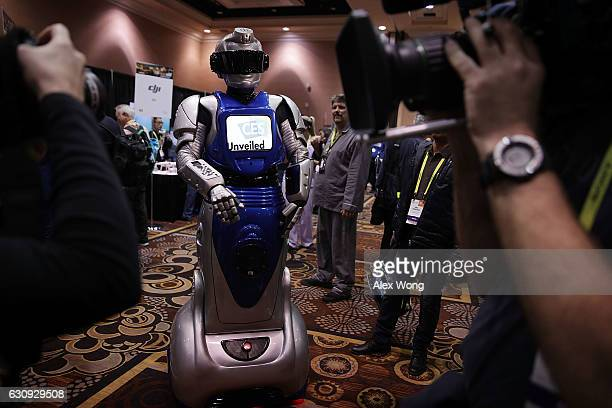 A robotic figure interacts with members of the media during a press event for CES 2017 at the Mandalay Bay Convention Center on January 3 2017 in Las...