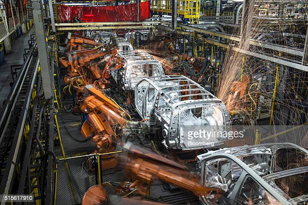 Robotic machines weld together the frames of sports utility vehicles during production at the General Motors Co assembly plant in Arlington Texas US...