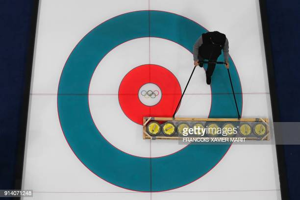 TOPSHOT A robotic overview shows an athlete training at the Gangneung Curling Center before the Pyeongchang 2018 Winter Olympic Games on February 4...