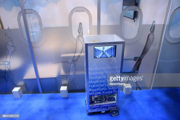 Robotic waiter catering device manufactured by Altran Technologies SA operates at the Aircraft Interiors Expo in Hamburg, Germany, on Tuesday, April...