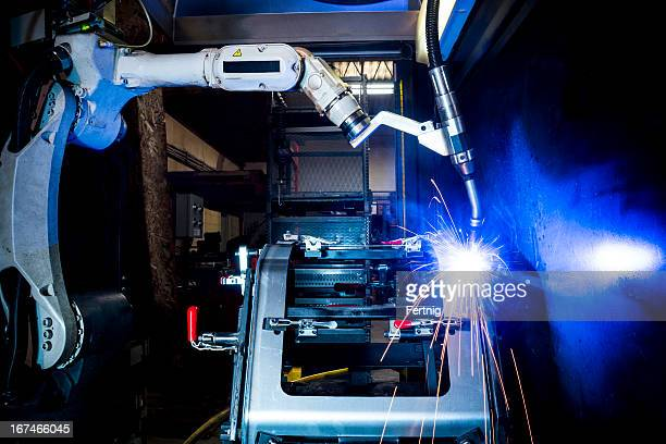 Robotic welding machine in a metal manufacturing plant