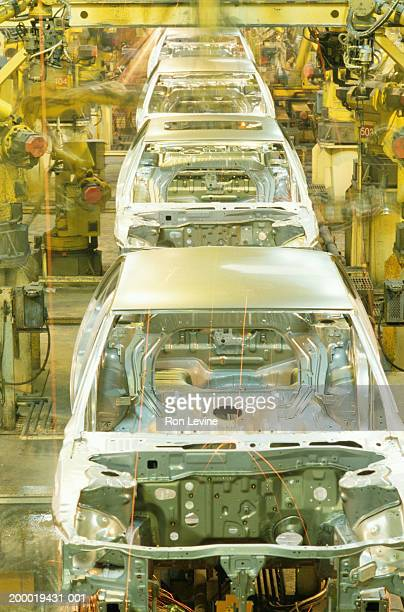 Robotic welding on auto assembly line, elevated view