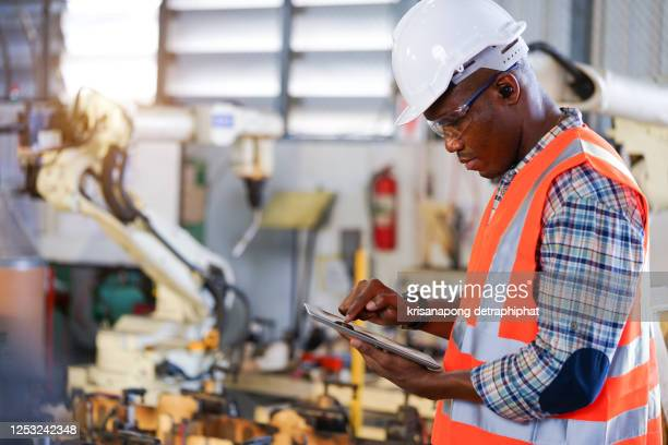 robotics control engineer in car part factory,engineer concept. - intelligence stock pictures, royalty-free photos & images