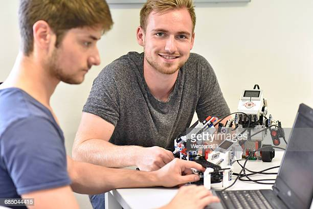 robotics students with laptop - mechatronics stock pictures, royalty-free photos & images