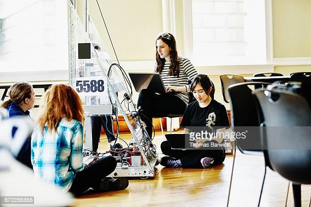 Robotics team preparing robot for competition