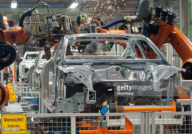 Robots assemble Audi A5 automobiles at the Audi AG plant in Ingolstadt Germany on Wednesday Feb 29 2012 Audi AG the world's secondlargest maker of...