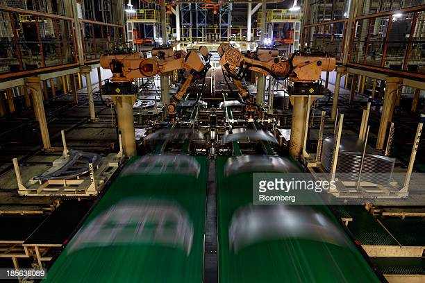 Robots assemble hoods for the Sonata and Elantra vehicles at the Hyundai Motor Manufacturing Alabama assembly plant in Montgomery Alabama US on...