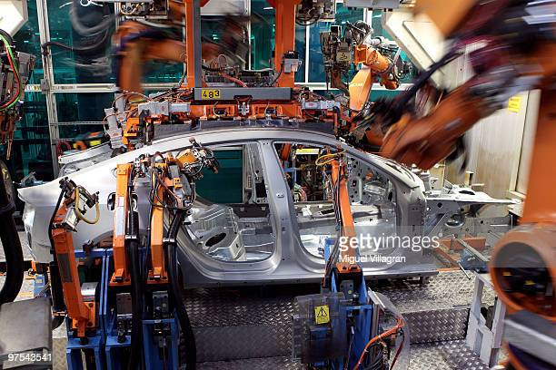 Robots braze the car body of an Audi A5 at the production line on March 8 2010 in Ingolstadt Germany Audi AG is a unit of Volkswagen AG