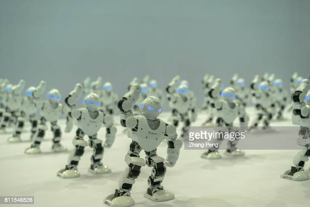 Robots dance for the audience on the expo On Jul 8th Beijing International Consumer electronics Expo was held in Beijing China National Convention...