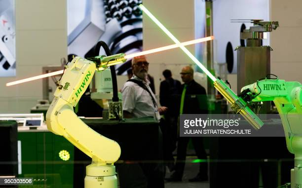 Robots from the company HIWIN from Taiwan swivel lightsabers during the Hannover Fair on April 23 2018 in Hanover Germany The Hanover technology fair...