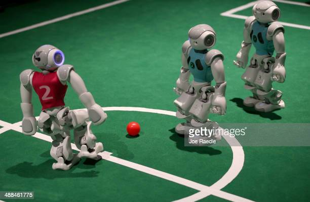 Robots from the University of Miami College of Arts and Sciences' Department of Computer Science play a game of soccer at the eMerge Americas...