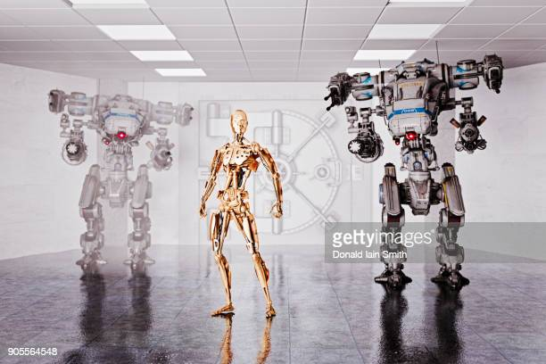 robots guarding vault at bank - guarding stock photos and pictures