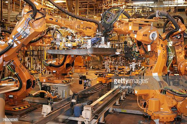 Robots help to assemble the allnew 2008 Chrysler and Dodge minivans at the Windsor Assembly Plant August 21 2007 in Windsor Ontario Canada The new...