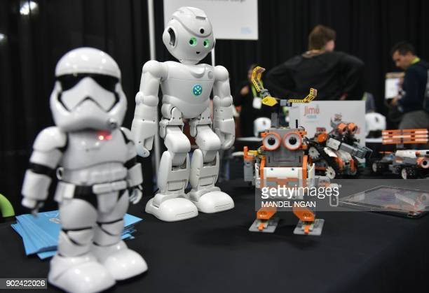 UBTECH robots including the First Order Stormtrooper and the Amazon Alexa voice assistant enabled lynx are seen during the CES Unveiled preview event...