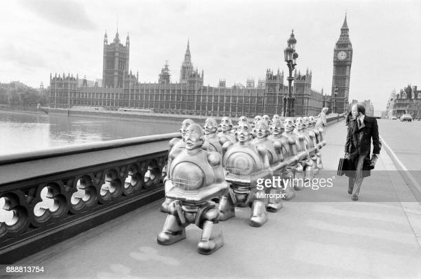 Robots lined up over Westminster Bridge The robots were supplied by EMI Records who used them on the cover of the latest album by 'Queen' The...