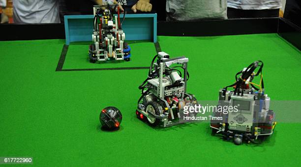 Robots made by students playing a football match in Kolkata during National Championship of World Robot Olympiad 2016 held at Netaji Indoor Stadium...