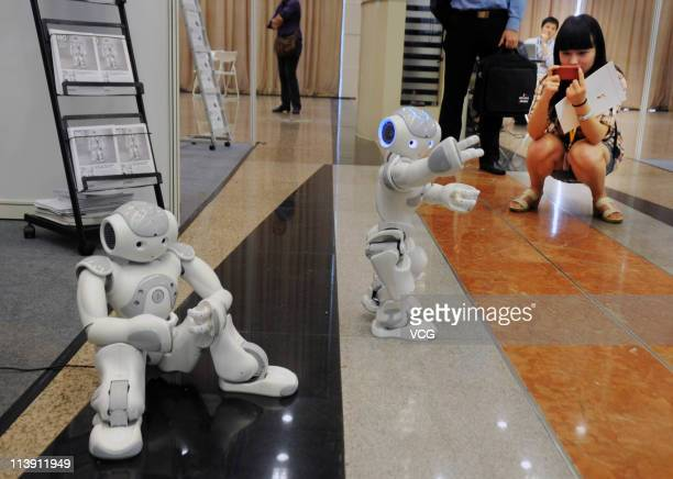 Robots NAO of France dance during the 2011 IEEE International Conference on Robotics and Automation at Shanghai International Conference Center on...
