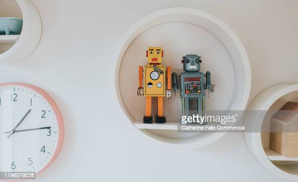 robots on a shelf - childhood stock pictures, royalty-free photos & images